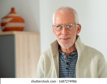 Senior man with grey hairs wearing eyeglasses