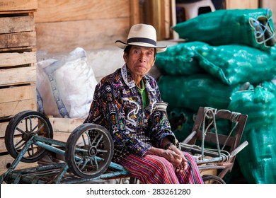 Senior man from Guatemala in ethnic traditional Latin American clothing at a market.
