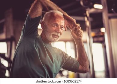Senior man at gym working exercise.