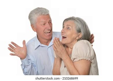Senior man happily surprised older woman on white background