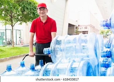 Senior man Happy Delivery Man Holding Trolley With Water Bottles