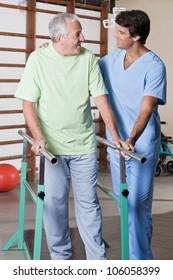 Senior man having ambulatory therapy with his therapist.