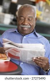 Senior man having morning tea