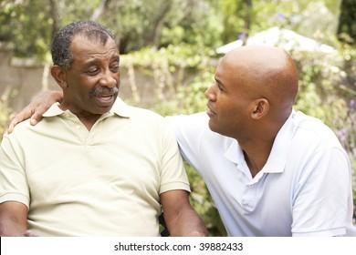 Senior Man Having Serious Conversation Adult Son