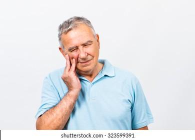 Senior man is having toothache.Toothache