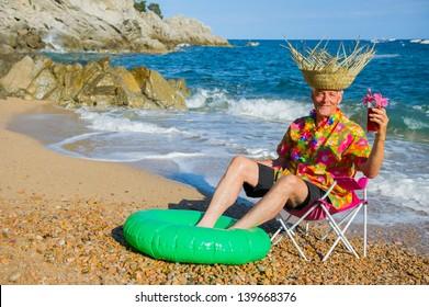 Senior man is having vacation at the beach
