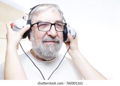Senior man with headphones - hearing test