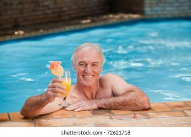 Senior man in his swimming pool