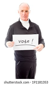 """Senior man holding a message board with the text words """"Vote"""""""
