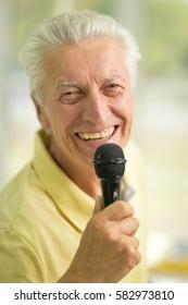 senior man holding  microphone