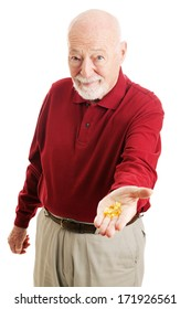 Senior man holding out a handful of omega 3 fish oil capsules.  Isolated on white.