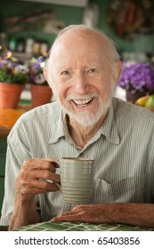 Senior man at home with coffee or tea