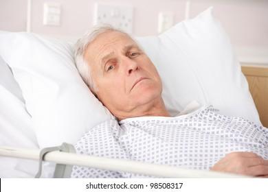 Senior man ill in hospital bed