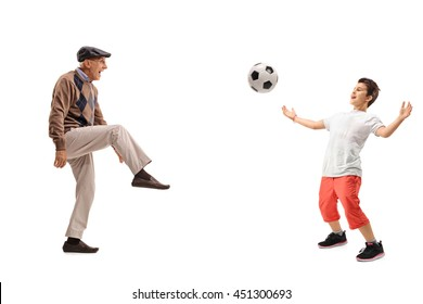 Senior man and a kid passing a football isolated on white background
