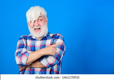 Senior man with long bangs and beard. Mature hipster unusual appearance. Subculture and lifestyle. Barbershop and hairstylist. Expressing himself hairstyle. Subculture attributes. Emo subculture.