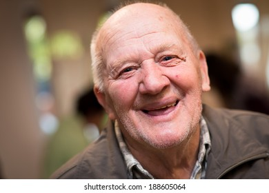 Senior man looking directly at the camera and smiling