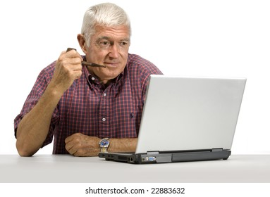 Senior man looking at a laptop on a white background