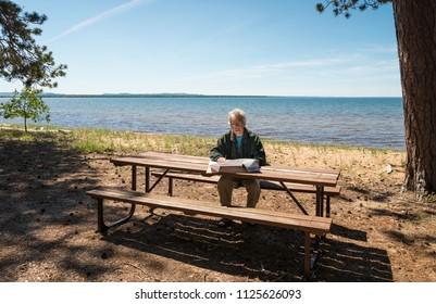 Senior man looking at a map