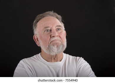 A senior man looking out into copy space