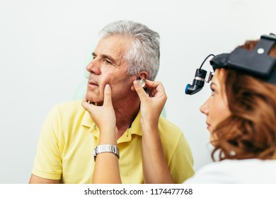 Senior man at medical examination or checkup in otolaryngologist's office