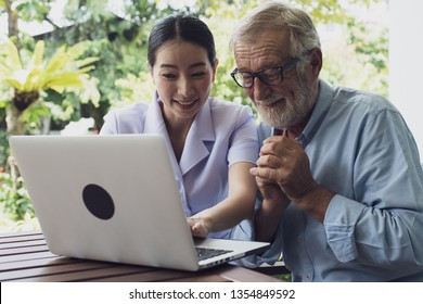 senior man and nurse, teaching and using laptop at balcony near garden at nursing home for internet online together