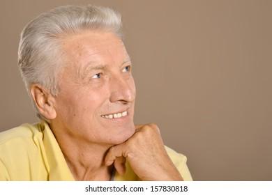 senior man on brown background