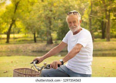 Senior man on cycle ride at park for exercise
