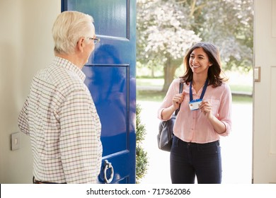 Senior man opens front door to young woman making home visit