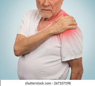 senior man with pain in his shoulder isolated on light blue background