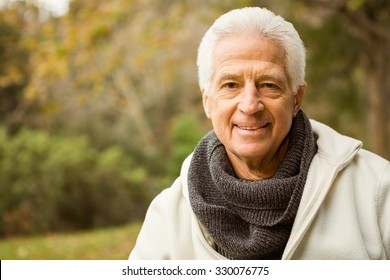Senior man in the park on an autumns day