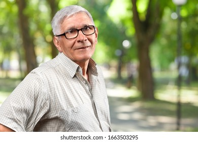 A senior man pensioner standing outdoors