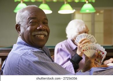 Senior man playing bridge