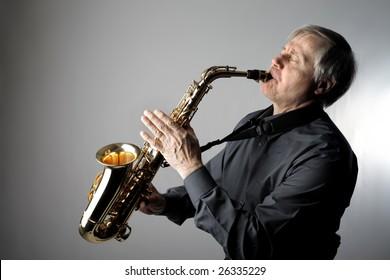 senior man playing the saxophone
