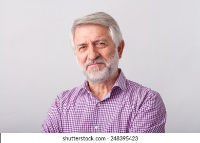 Senior man./ Portrait of senior man with white beard over a white background