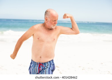 Senior man posing with his muscles on a sunny day