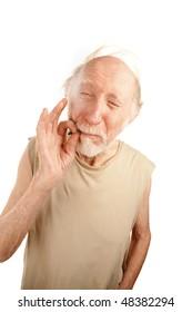 Senior man in ragged shirt smoking cigarette stub or marijuana reefer