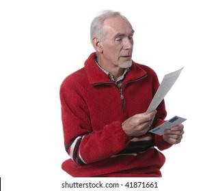 Senior man reading handwritten letter