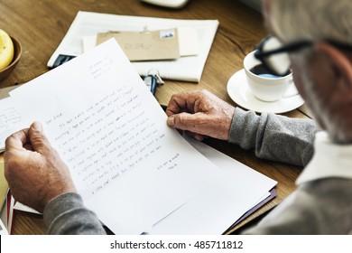 Senior Man Reading Letter Message Concept