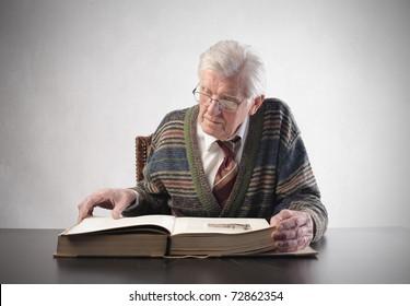 Senior man reading an old book