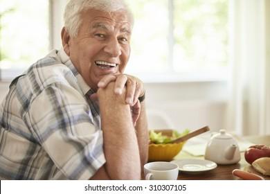 Senior man relaxing after breakfast
