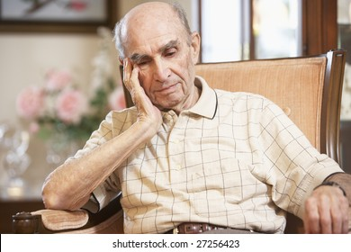 Senior man resting in armchair