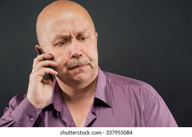 senior man serious portrait with mustache and bald with telephone