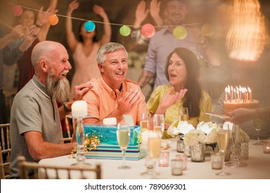 Senior man is shocked after being treated to a birthday party surprise.