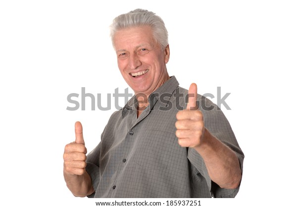 Senior man showing thumbs up standing on white background