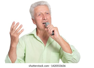 Senior man singing with microphone on white background