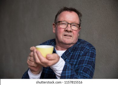 Senior Man Sitting Enjoying Coffee
