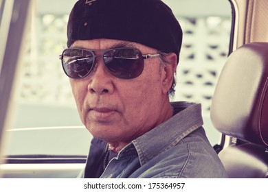 Senior Man Sitting in his car