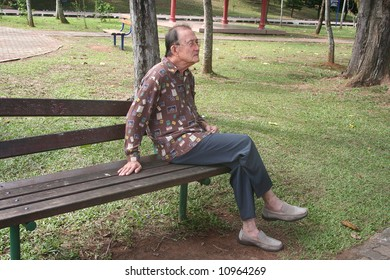 Senior man sitting on the bench in the park