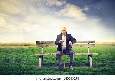 senior man sitting on a bench outdoor