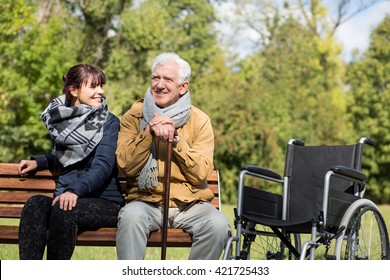 Senior man sitting on the bench in park